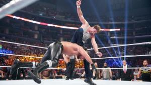 Photo by WWE Dean Ambrose gives Seth Rollins a curb stomp
