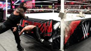 Photo by: WWE Seth Rollins narrowly dodges a cinder block to the face from Roman Reigns